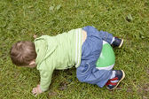 Little cute boy lying on the ball — Stock Photo