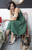 Housewife in green dress — Stock Photo
