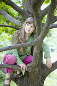 Girl hang on tree — Stock Photo