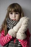 Little cute upset  girl with scarf — Stock Photo
