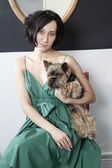 woman wearing green fashionable dress with her terrier — Stock Photo