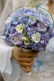 Bride hold bouquet — Stock Photo