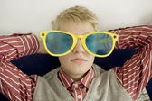 Portrait of young man in big glasses — Stock Photo