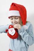 Girl in red Santa's hat — Stock Photo