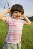 Little cute pensive girl five years old standing on  park — Stock Photo