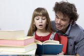 Father and daughter read book — Stock Photo