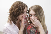 Two happy young woman gossip — Stock Photo