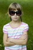 Little cute girl playing spy — Stock Photo