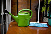 Watering-can tool for flowers watering    with brush at house — Stockfoto