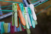 Clothepins on the line — Stock Photo