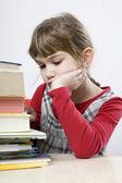 Chica triste con una pila de libro — Foto de Stock