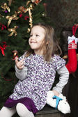 Portrait of smiling girl six years olf near Christmas tree — Stock Photo