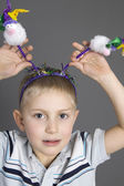 Funny boy with horns — Stock Photo