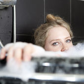 serious woman enjoys the bath-foam in the bathtub. — Stock Photo