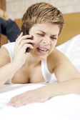 Upset female blond with a cellphone — Stock Photo