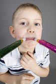 Funny boy with whistles — Stock Photo