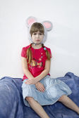 Surprised little girl with two plaits — Stock Photo