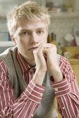 Blond man sitting on stairs — Stock Photo