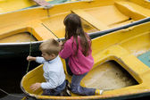 Friendship. Children playing in yellow boat. Summer time — Stock Photo