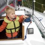 Little cute boy  in life jacket on yacht. — Stock Photo #45384047