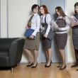 Four businesswoman standing in line — Stock Photo #45384187