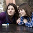Two teen girls sitting in street cafe — Stock Photo #45388587