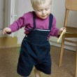Little cute blond boy one years old walking around room — Stock Photo #45388721