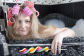 Smile girl with hair curlers take a buth — Stock Photo