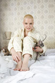 Young  bald blond woman wearing pyjamas — Foto Stock