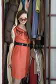 Girl wearing stylish glasses go out from wardrobe. Young attract — Stock Photo