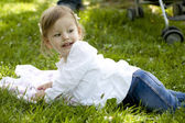 Little girl resting on meadow — Stock Photo