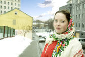 Beautiful woman wearing russian headscarf  — Stockfoto