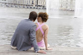 The newly married couple at city. Bride in pink dress — Stockfoto