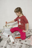Young girl with paint-brush. — Stock Photo