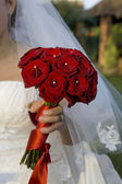 Bride holding a bouqet — Stock Photo