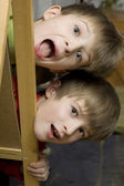 Happy twins brothers shouting — Stock Photo