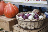 Red and white onion and wicker baske — Stock Photo