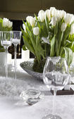 White tulips on  dining table — Stock Photo