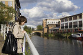 Woman walking around Regent Canal in London — Stock Photo