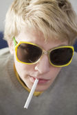 Blond funny man smoking cigarette — Stock Photo