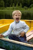 Boy in boat — Stock Photo
