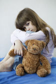 Little girl with toy bear — Stock Photo