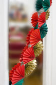 Red and green garlands before Christmas — Stock Photo