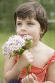 Portrait of young little cute girl with flower.  — Stock Photo