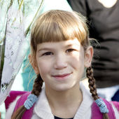 Smiling girl with plaits — Stock Photo