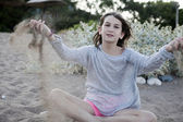 Teenager playing with sand — Stock Photo