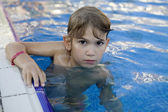 Sad girl swimming in swimming pool — Stock Photo