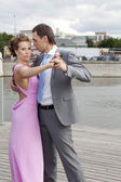 Happy newlyweds dancing at river — Stockfoto