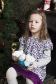 Portrait of smiling girl six years olf near Christmas tree — Foto de Stock