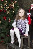 Portrait of smiling girl six years olf near Christmas tree — Stock Photo